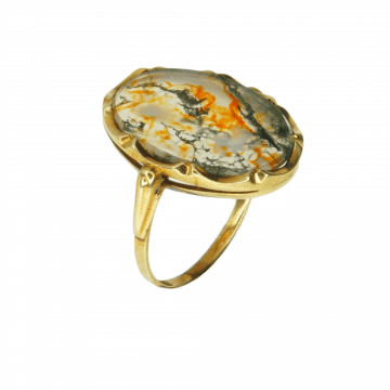 A ring with a gold and diamond inlay