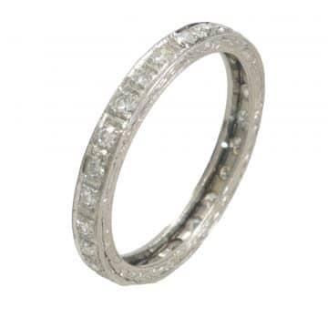 Thin titanium ring and diamonds